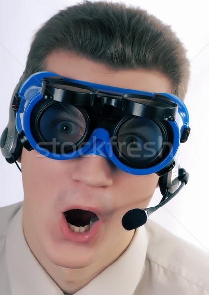 Empresário retrato jovem microfone fones de ouvido óculos Foto stock © Andriy-Solovyov