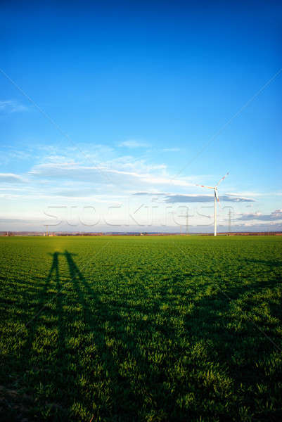 Landscape with wind turbines and shadows of people Stock photo © Anettphoto