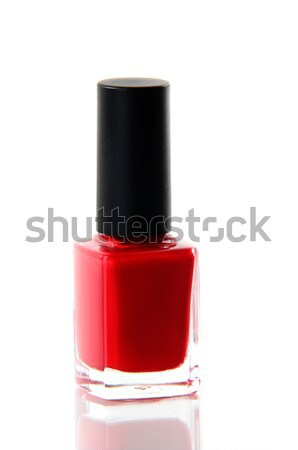 Red nail polish bottle over white Stock photo © Anettphoto