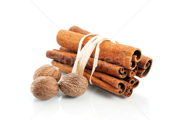 Tied cinnamon sticks and nutmeg over white Stock photo © Anettphoto