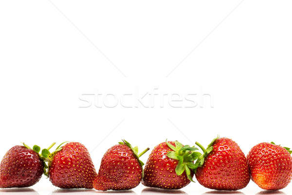 Red strawberries in a row Stock photo © Anettphoto