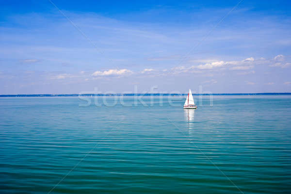 Blue landscape with sailboat Stock photo © Anettphoto