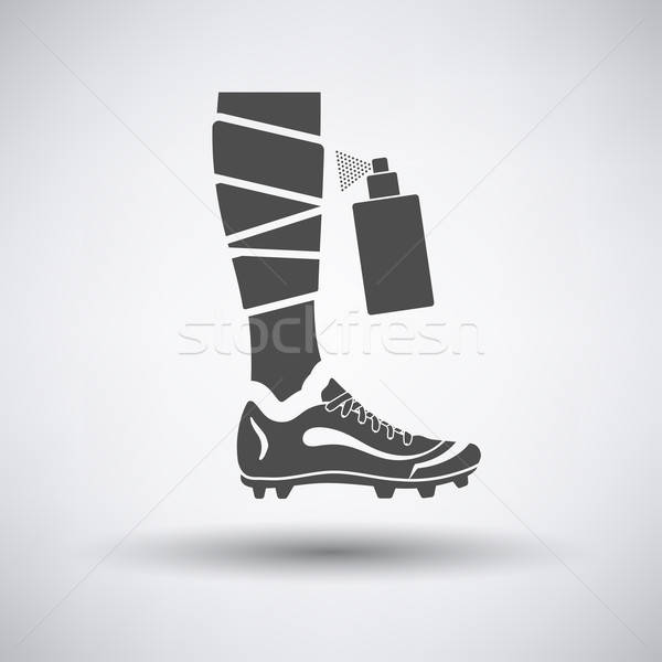 Soccer bandaged leg with aerosol anesthetic icon Stock photo © angelp