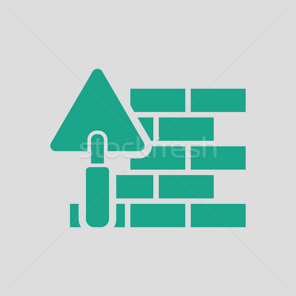 Icon of brick wall with trowel Stock photo © angelp
