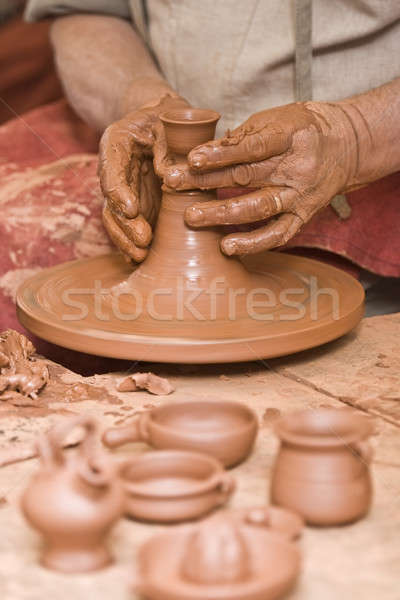 Working with raw clay. Stock photo © angelsimon