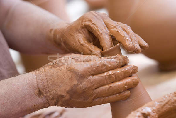 Hands and clay. Stock photo © angelsimon