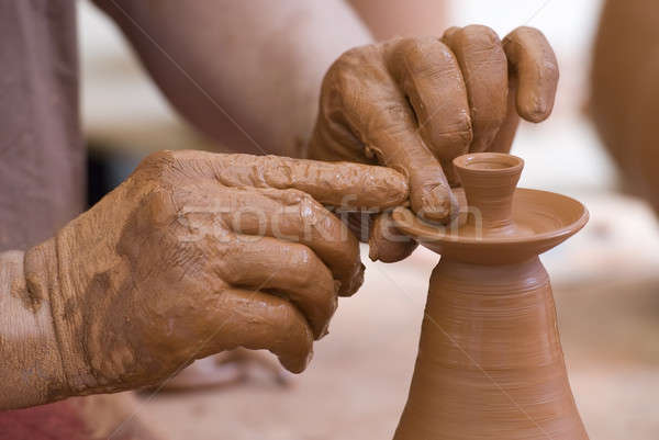 Potter working with clay. Stock photo © angelsimon