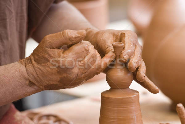 Potter's hands working. Stock photo © angelsimon