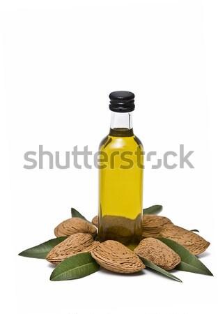 Foto stock: Amêndoa · em · torno · de · garrafa · Óleo · isolado
