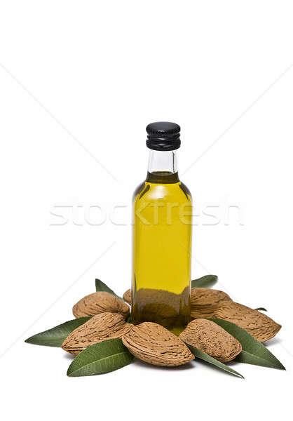 Vers amandel olie amandelen fles geïsoleerd Stockfoto © angelsimon