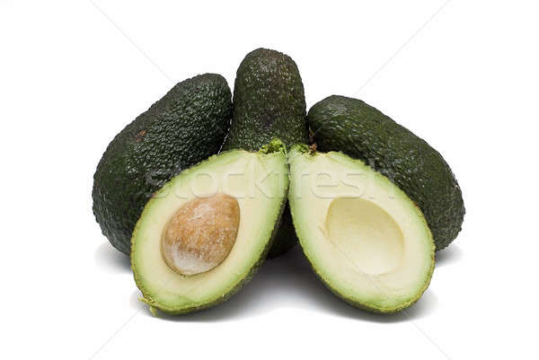 Three avocados and one cut. Stock photo © angelsimon