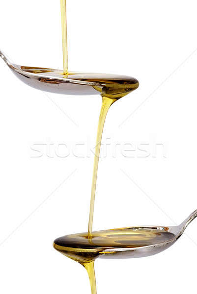 Tow spoons with olive oil. Stock photo © angelsimon