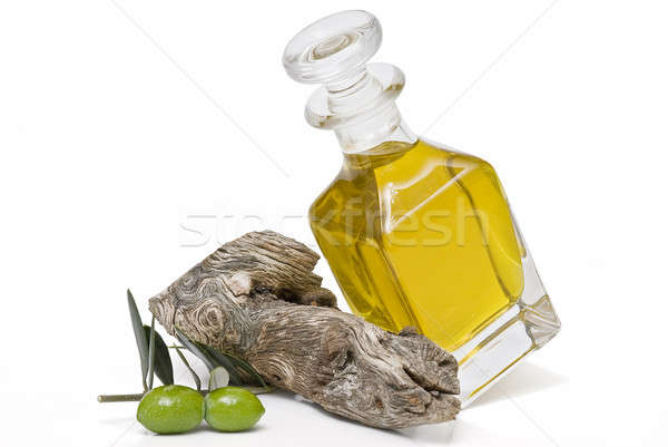 Bottle of oil and two olives. Stock photo © angelsimon