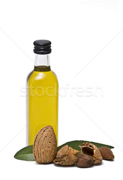 Fles amandel olie amandelen geïsoleerd witte Stockfoto © angelsimon