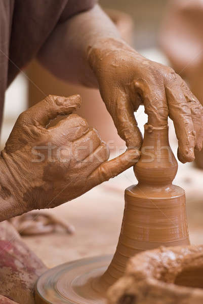 Potter's hands. Stock photo © angelsimon