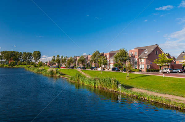 Peaceful quiet suburban with expensive houses on lake in Europe Stock photo © anmalkov