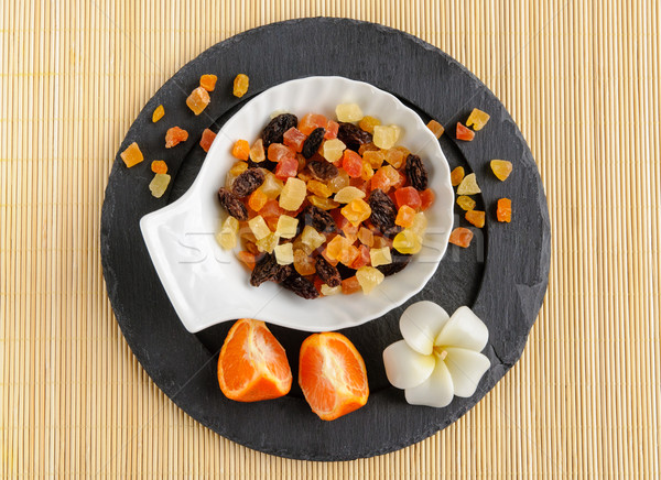 Dried fruits on stone plate with flower Stock photo © anmalkov