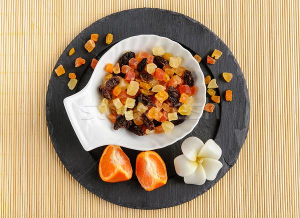 Secado frutas piedra placa flor oscuro Foto stock © anmalkov
