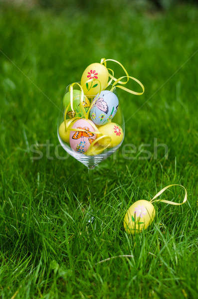 Painted easter eggs in glass on green grass Stock photo © anmalkov