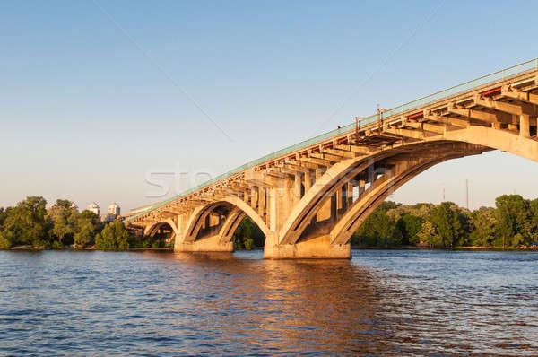 Concrete bridge across a river at sunset Stock photo © anmalkov