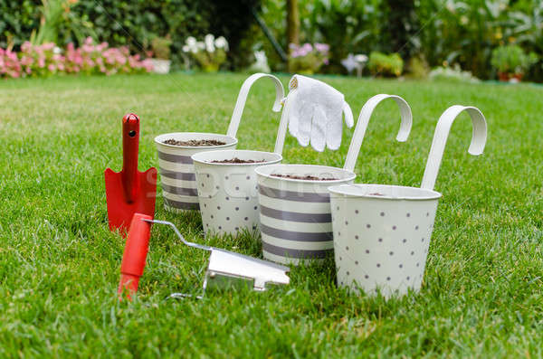 Stock photo: Flowerpots and garden hand tools