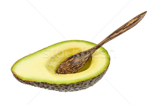 Fresh avocado with wooden spoon isolated Stock photo © anmalkov