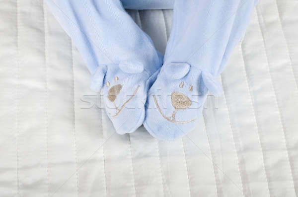 Closeup of a baby wearing rompers body in bed Stock photo © anmalkov