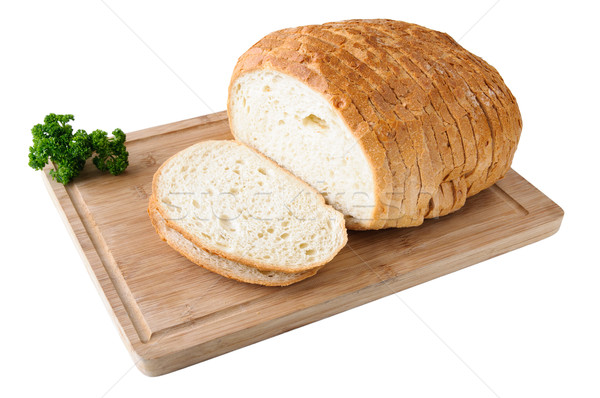 Sliced white bread on the wooden board with parsley Stock photo © anmalkov