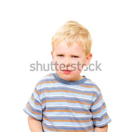 Angry and serious beautiful boy isolated on white Stock photo © anmalkov