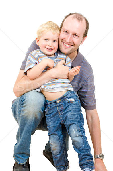 Stock photo: Happy father and son are playing isolated