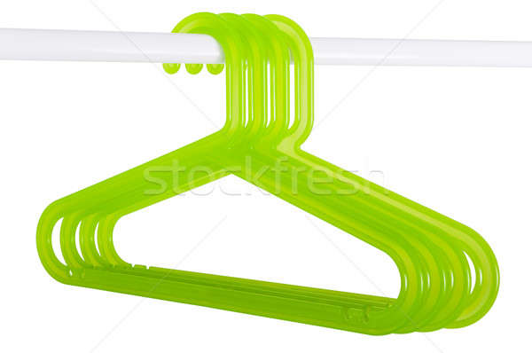 Green hangers on a rod isolated on white Stock photo © anmalkov