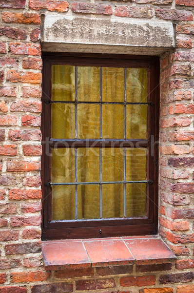 Window of a medieval building with old brick wall Stock photo © anmalkov