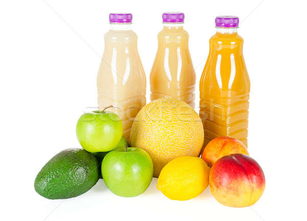 Fresh bottles of juice with fruits isolated on white Stock photo © anmalkov