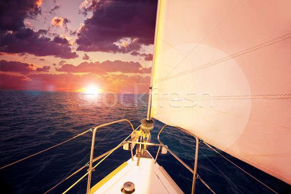 Romântico pôr do sol velejar barco dramático céu Foto stock © Anna_Om