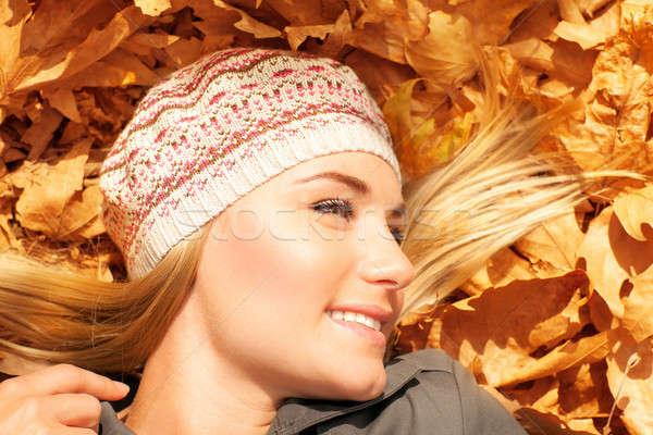 Stock photo: Pretty female on autumn background