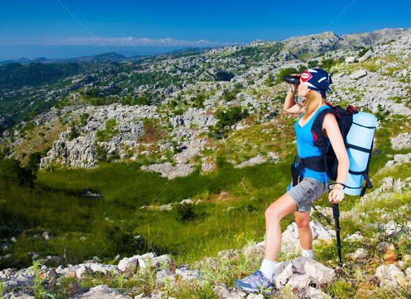 Female in mountains look in binocular Stock photo © Anna_Om