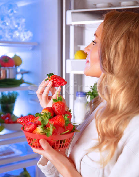 Woman eating strawberry Stock photo © Anna_Om