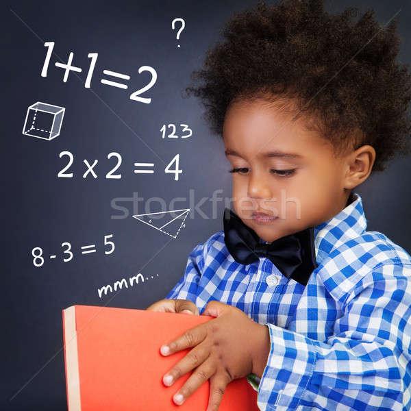 Piccolo ragazzo math lezione holding hands libro Foto d'archivio © Anna_Om