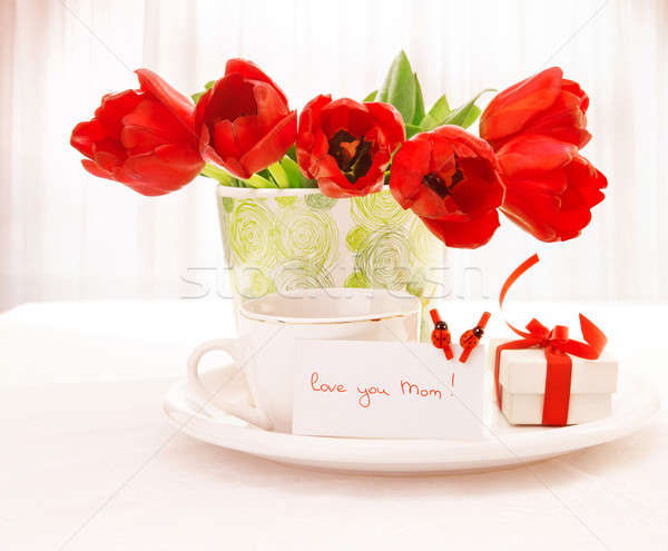 Red tulips and cup of tea Stock photo © Anna_Om