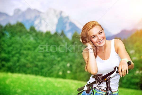 Happy woman cycling Stock photo © Anna_Om