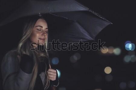 Calm female enjoying rainy night Stock photo © Anna_Om