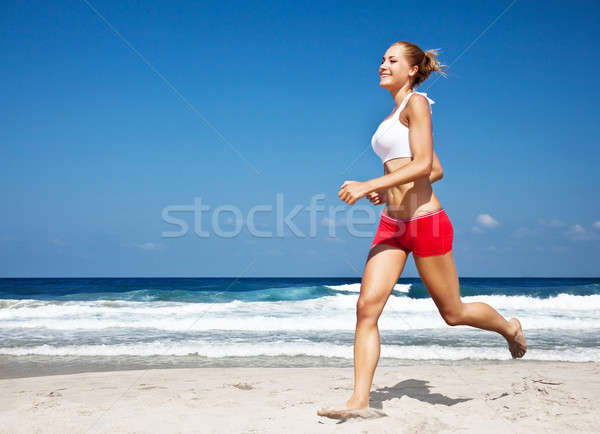 Healthy woman running on the beach Stock photo © Anna_Om