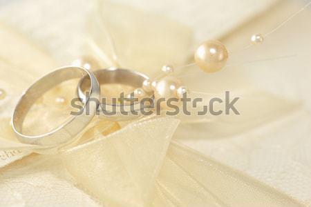 обручальными кольцами жемчуга металл серебро лук Сток-фото © Anna_Om