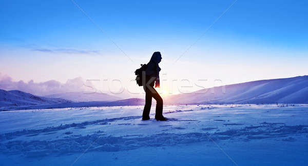 Stock photo: Woman traveler hiking in winter mountains