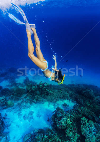 Woman diving to the sea bottom Stock photo © Anna_Om