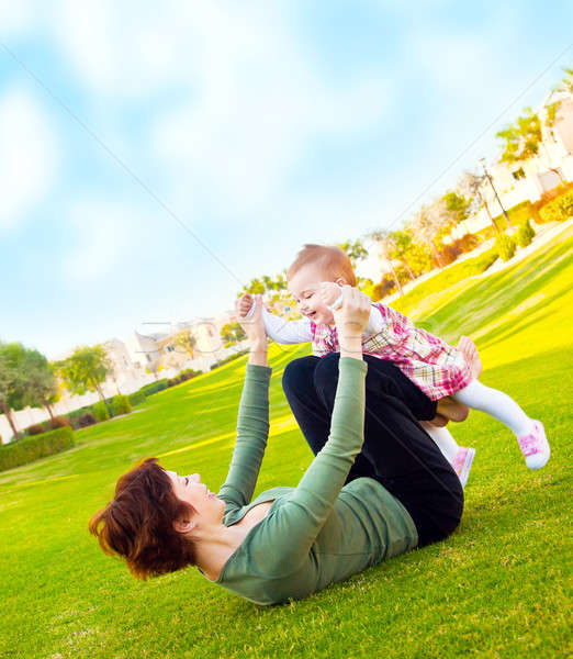 Stock photo: Mother and baby girl playing outdoor