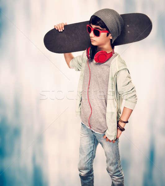 Stylish guy with skateboard  Stock photo © Anna_Om