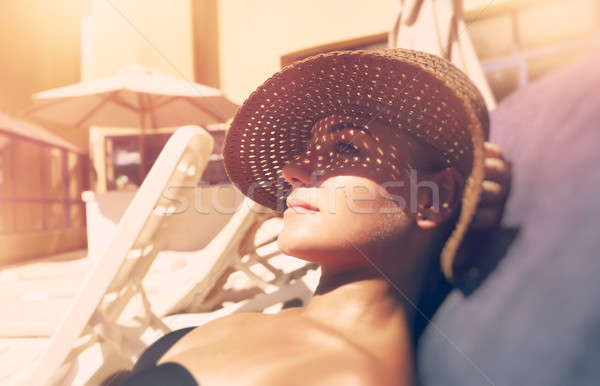 Attractive woman tanning on the beach Stock photo © Anna_Om