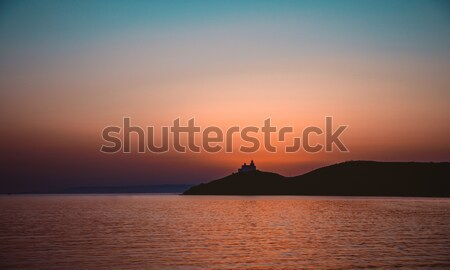 Stock fotó: Sziluett · világítótorony · naplemente · gyönyörű · este · panorámakép