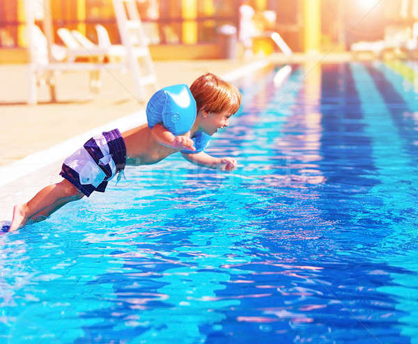 Small boy jumping to the pool Stock photo © Anna_Om